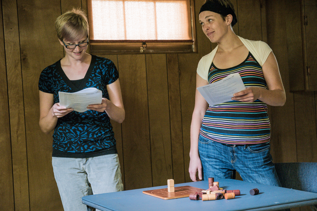 "Vanessa Vesperman (left) and Kate Boomsma explore a game only two can play in ""Zwei Personen."""